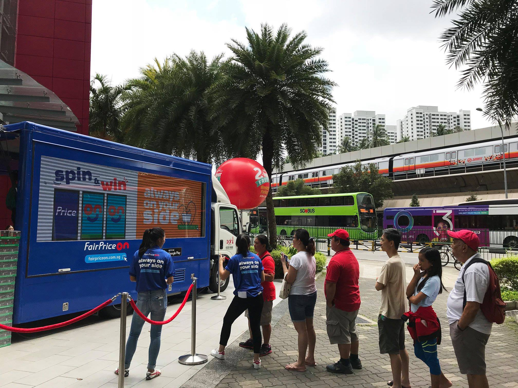 People queueing for their turn at the Fairprice On Interactive Spin & Win Game