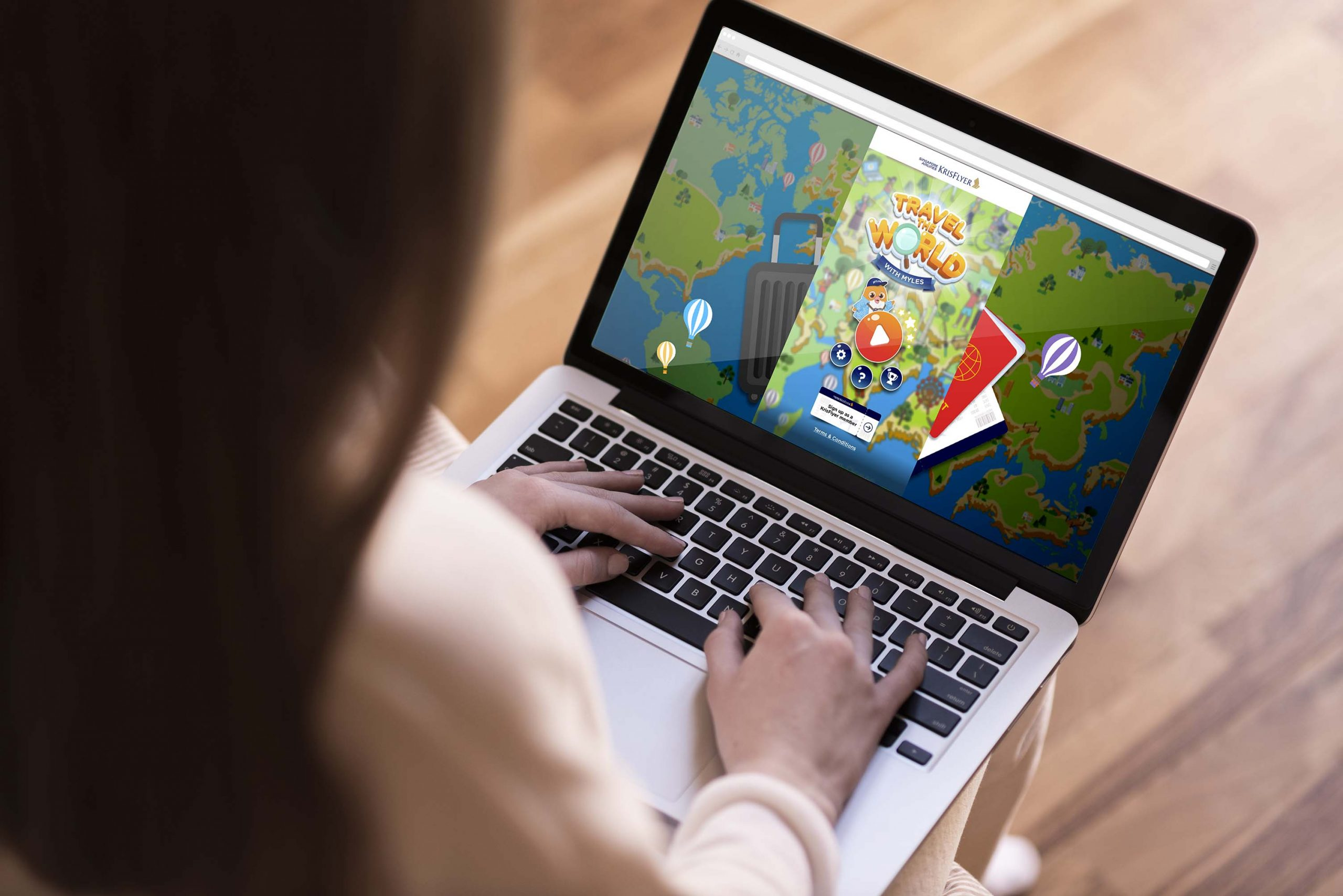 lady using laptop playing sia interactive microsite game