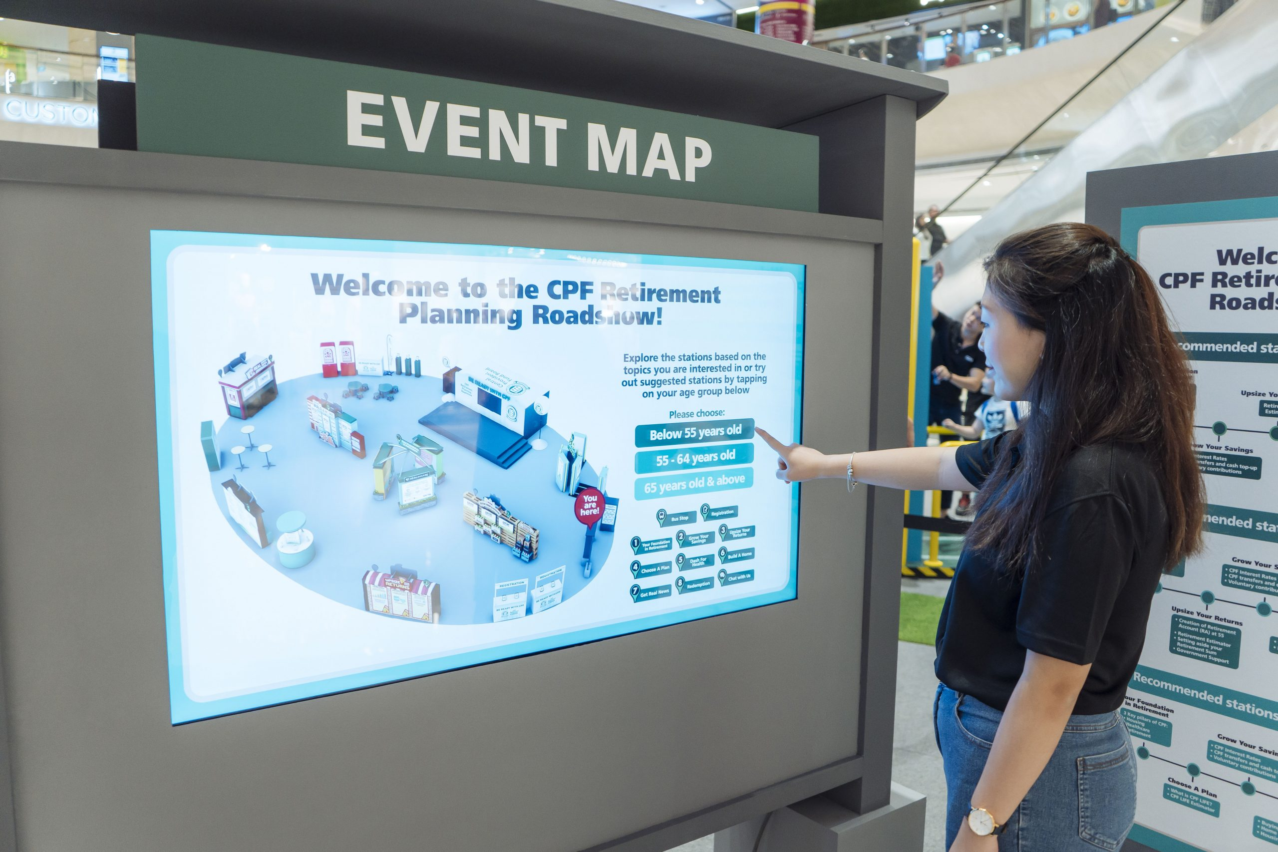 A girl using the CPF Interactive Event Map at the CPF Retirement Planning Roadshow